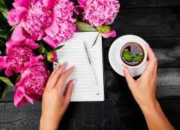 woman-hand-writing-diary-or-letter-note-with-cup-of-tea-260x188.jpg